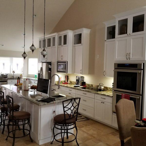 Designer Kitchen Cabinets, Granite Countertops and Travertine Tile